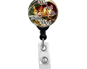 We Are All Mad Here Badge Holder Custom Alice In Wonderland Name ID Badge Reel - Smiling Cheshire Cat Color Background