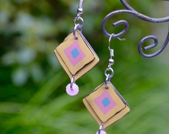 Upcycled cookie tin earrings in yellow, pink and gray/blue with glam pink plastic donut shaped accent bead