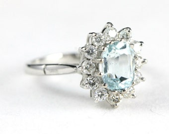 Aquamarine and diamond ring in 18 carat gold for her