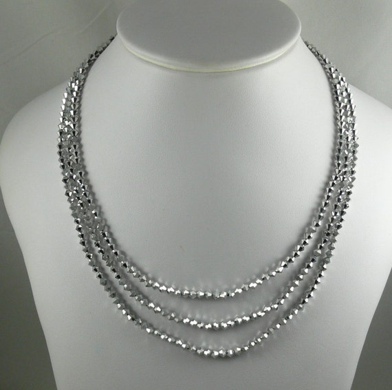 Comet Double Coated Crystal Triple Strand Necklace with Silver Clasp 18.5 Inches