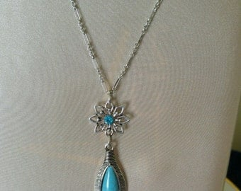 "SOUTHWESTERN STYLE TURQUOISE Teardrop Necklace,Dangles from Silver Filigree with Aqua Stone in Center,Silver Chain 15 1/2"" Extends to 18""."