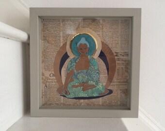 Collage with reclaimed newsprint buddha
