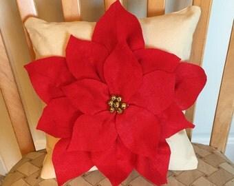 Red Christmas Pointsettia on beige pillow