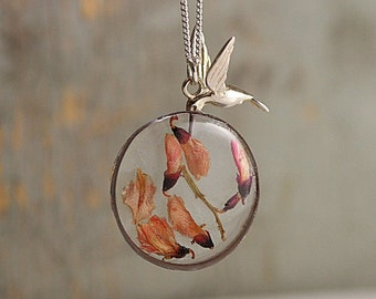 SALE 40% OFF: Sterling hovering hummingbird with its beak in real flowers in resin. Hummingbird necklace. Dainty. 925 sterling silver.