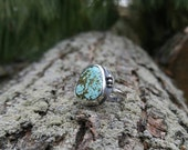 Nevada Turquoise Sterling Silver Ring with Silver Pebbles. Light Blue Turquoise with Olive Green Veining. US Size 7-1/4