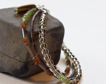 Three strand, smokey quartz, peridot, hessonite, olive shell and silver bracelet