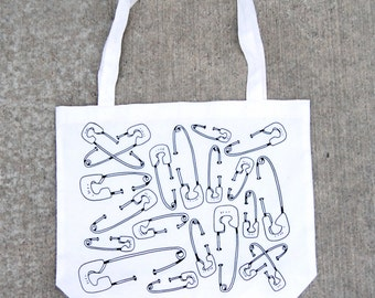 Over sized tote bag. large tote bag. gifts for women. bags and purses. accessories. screen printed with safety pins.