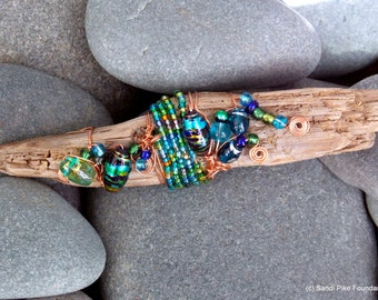 deep blue sea / driftwood art / wire wrapped / beaded / glass beads / from the sea / shades of blue / copper and glass / table art
