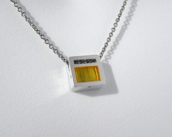 Contemporary Golden Necklace – Minimalist Contemporary Jewelry Design