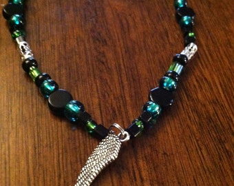 Green and black winged choker