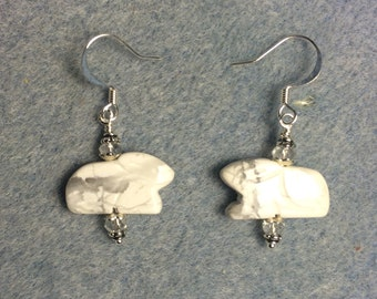 White howlite gemstone Zuni rabbit fetish bead earrings adorned with clear Chinese crystal beads.