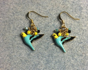 Turquoise, yellow and black enamel parakeet charm earrings adorned with tiny dangling turquoise, yellow and black Chinese crystal beads.