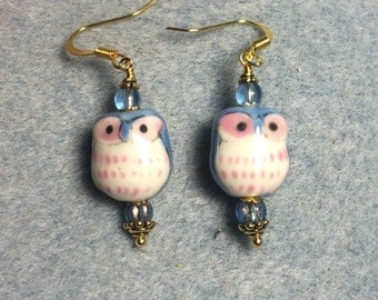 Light blue and pink ceramic owl bead dangle earrings adorned with light blue Czech glass beads.