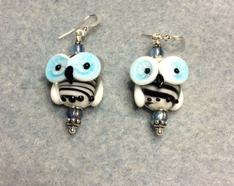 Black and turquoise lampwork owl bead earrings adorned with turquoise Czech glass beads.