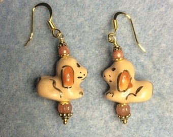Orange brown ceramic puppy dog earrings adorned with orange brown Czech glass beads.