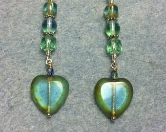 Light blue green Czech glass heart bead dangle earrings adorned with light blue green Czech glass beads.