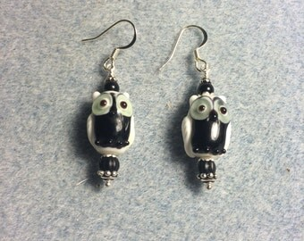 Black and white lampwork owl bead earrings adorned with black Czech glass beads.
