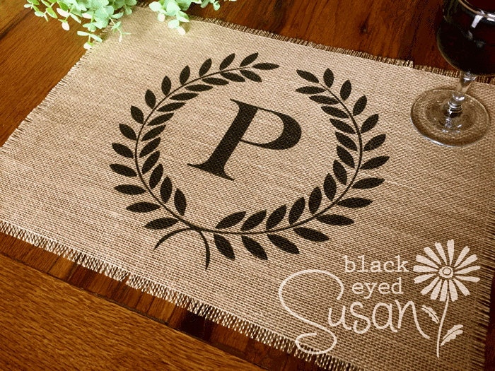 monogram laurel wreath placemat of natural burlap with raw and
