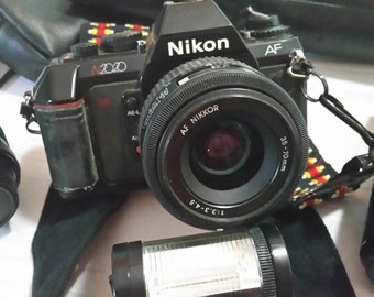 Vintage Nikon N2020 Camera With 3 Lenses And Accessories