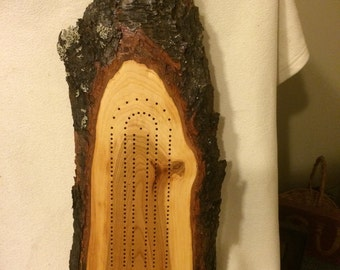 Cherry wood cribbage board.