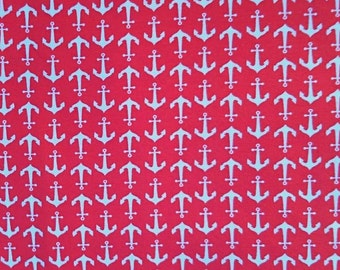 Jersey knit, stretch fabric, white anchors on red background