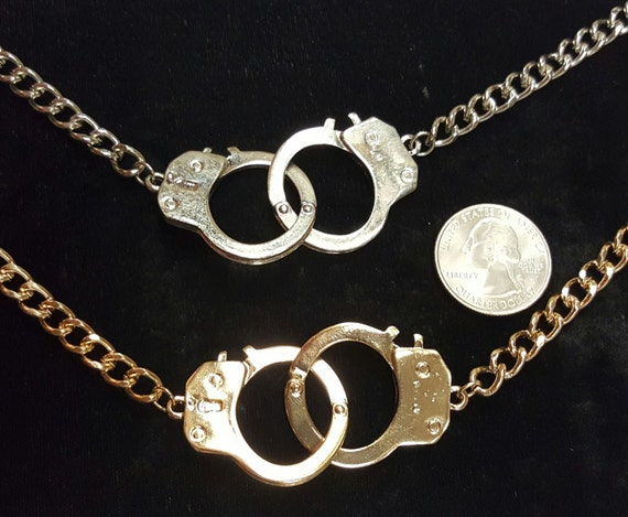 handcuff necklace in silver and 18k gold plated by