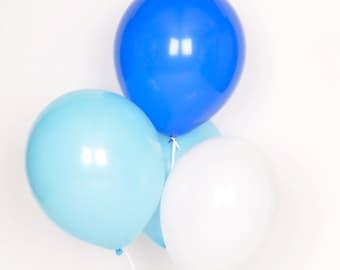 10 blue assorted balloons: royal blue, powder blue, white