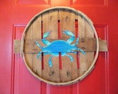 Blue or red crab hand painted on recycled crab bushel lid.