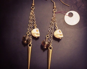 Skull, spike and crystal earrings with gold plated chain.