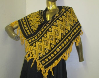 vintage 70s Guatemalan fringed poncho in a vibrant bold print