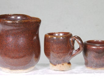 Miniature Deep Red-Brown Hand Thrown Stoneware Pitcher and Two Mugs.