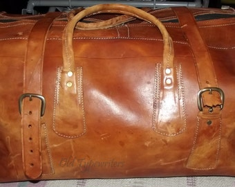 Large brown leather vintage case with brown clean lining inside.
