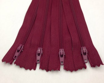 Four pack of 8 inch zippers in deep berry colour