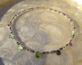 gemstone necklace with moss and green aquamarine tourmaline tanzanite amethyst and sterling silver