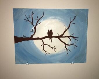 Love Birds sitting on a tree