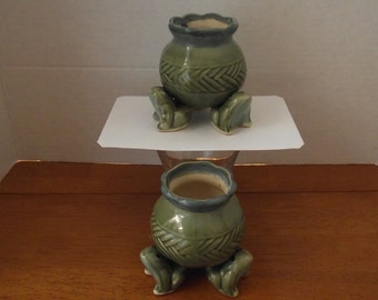 Two Pots With Frogs For Legs