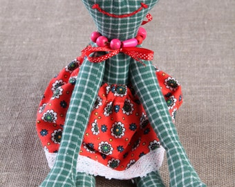 Green frog wearing red dress  - home interior decor