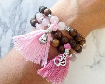 Handmade, one-of-a-kind Bracelet Set with Rose Quartz, Sandalwood, Pink Tassles, Buddha and Om Charms