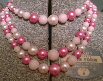 Vintage pink plastic pearl necklace and earrings