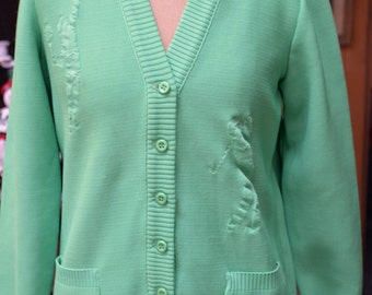 Light Green Knit Blouse with 1 Tennis players and pocket on each side,  by Hadley.