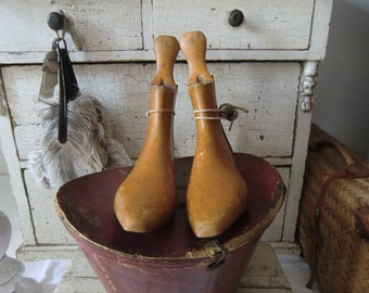 Vintage antique shoe lasts wood shoe tree ancient craft of shoemaking workshop rustic french shabby