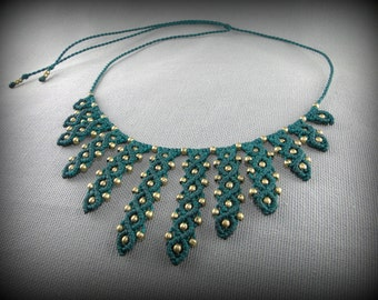 Macrame necklace adorned with brass beads. Green woven necklace with multiple brass beads. Elegant necklace.