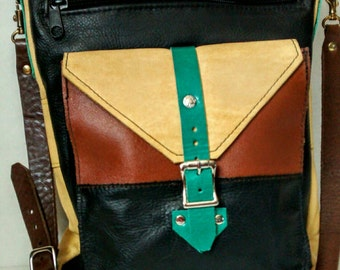 CROSS BODY BAG, all leather materials. It's light, good color composition with 4 pockets total.