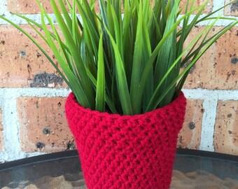 Artificial plant with handmade crochet cozy