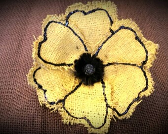 Yellow burlap flower with black accents