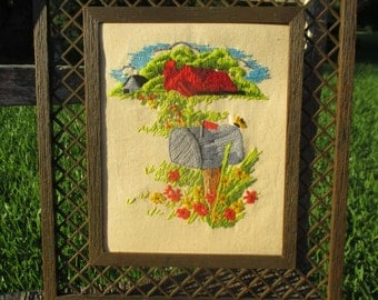 vintage 80s crewel featuring a red barn, mailbox on post, and wild flowers, framed crewel, retro crewel, crewel art, floral crewel, country
