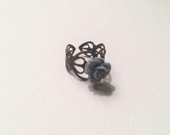 Adjustable light blue floral ring
