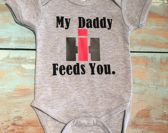 Case IH baby My Daddy Feeds You onesie.