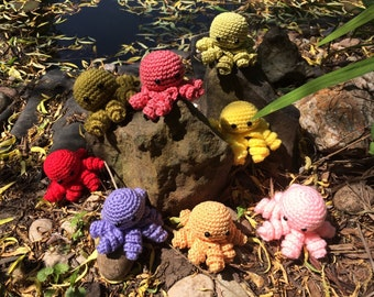 The octo clan- orange,red,pink,yellow miniature crochet octopus.