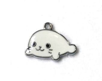 1-5 White Seal Pup Charms. Enameled colored front with smooth back. Nice quality. Arctic Seal Endangered wildlife